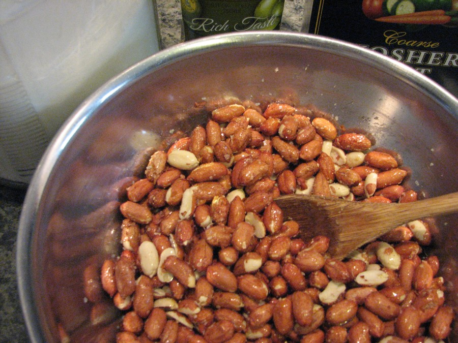 Stir to coat peanuts with salt, olive oil, and sugar