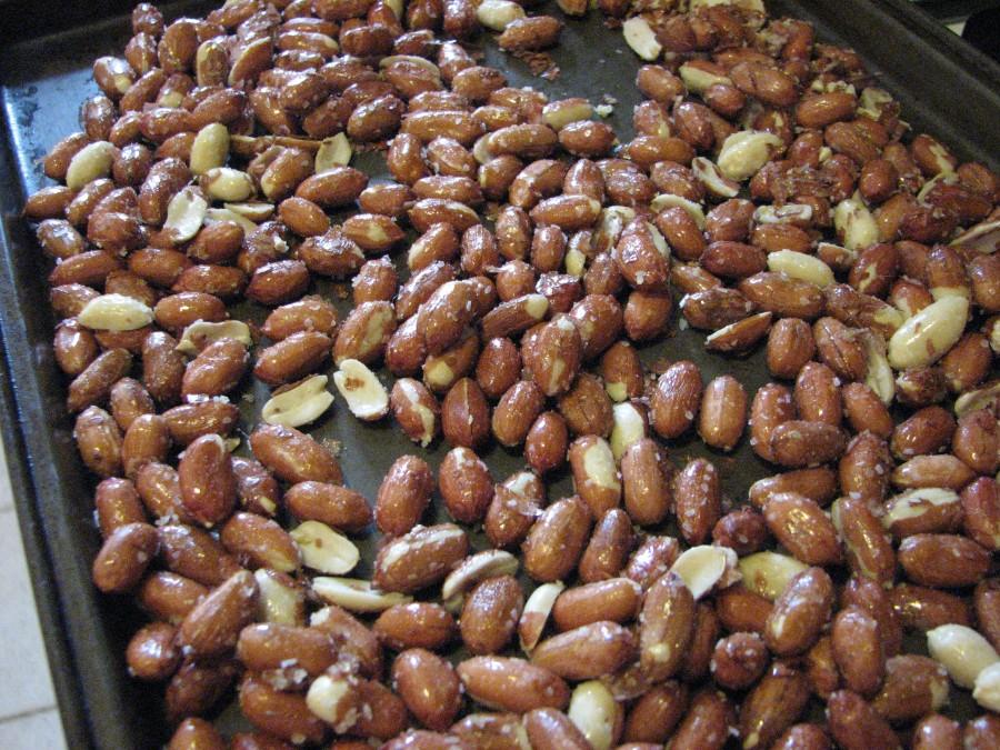 Spread peanuts onto baking sheet
