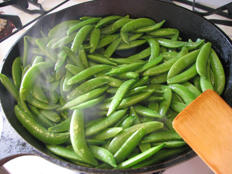 Add snap peas to skillet